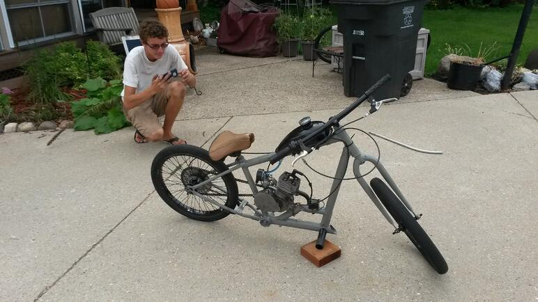 Mitchell with a motorized bike he built.