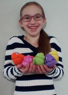 One happy kid: Lydia shows off her prizes she won for vision therapy progress. Yay Lydia!